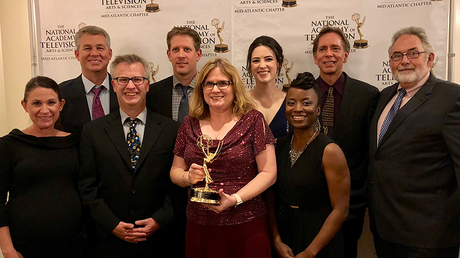 WPSU team holding an Emmy Award